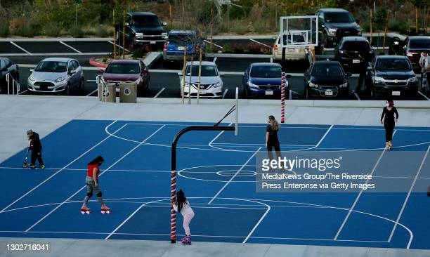 Roller skaters enjoy the new blue basketball courts as the $20 million long-awaited renovation project continues with new playground equipment, skate...