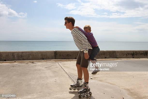 Roller skating brother gives piggyback