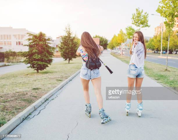 roller skating downtown - inline skate stock photos and pictures