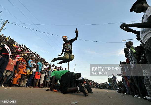 A rollerblader jumps over several people on the last day of the 34th Popo carnival in Bonoua 60km south of Abidjan on May 3 2014 The festival this...