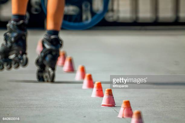 rollerblading skating - cone shape stock photos and pictures