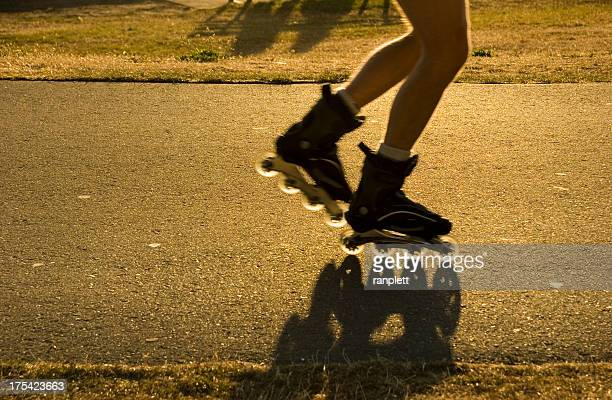 rollerblading through the park at sunset - english bay stock photos and pictures