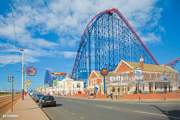 rollercoaster behind big blue hotel at blackpool pleasure beach - blackpool beach stock pictures, royalty-free photos & images