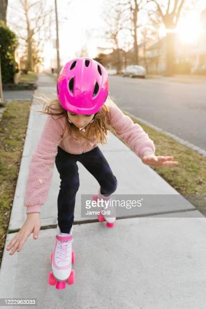 rollerskating girl losing balance - montclair stockfoto's en -beelden