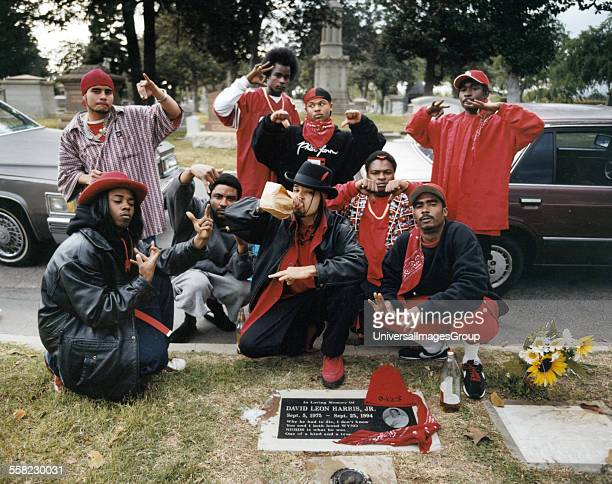Rolling 20's Bloods Rolling 20's Bloods sitting in front of their homeboy's gravesite.
