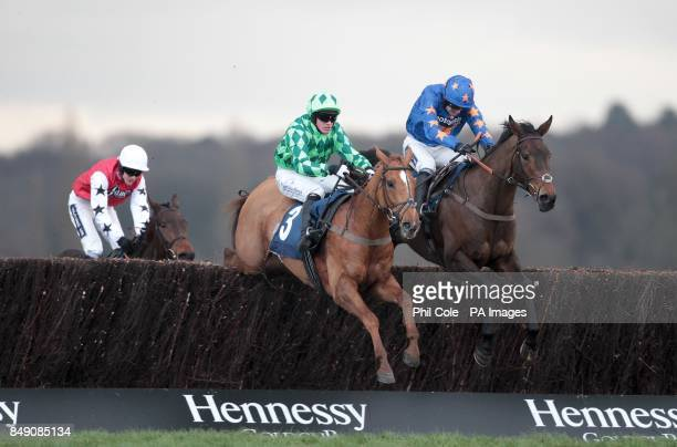 Rolling Aces ridden by Ruby Walsh goes on to win the frootfalcouk Sure Bet For Cashback Novices' Handicap Chase during the The Sportingbet Winter...