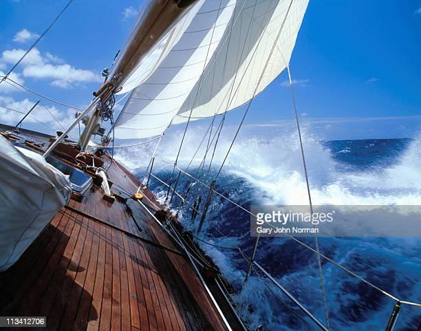 rolling deck of yacht crashing through waves - 船のデッキ ストックフォトと画像