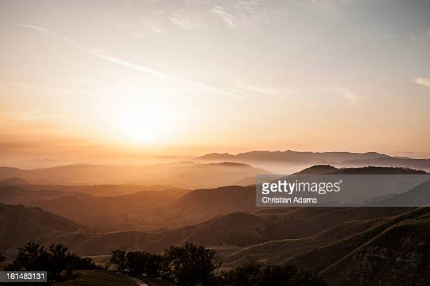 rolling hills at sunset - hill range stock pictures, royalty-free photos & images