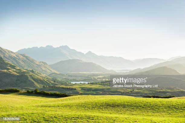 rolling hills in rural landscape, queenstown, south island, new zealand - landscape stock pictures, royalty-free photos & images