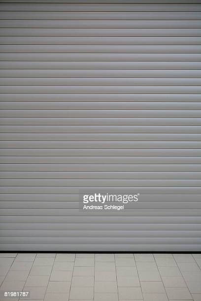 rolling industrial door - roller shutter stock pictures, royalty-free photos & images