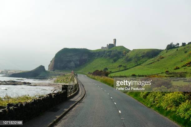rolling landscape and ruined castle at glenariff, county antrim of northern ireland - nordirland bildbanksfoton och bilder