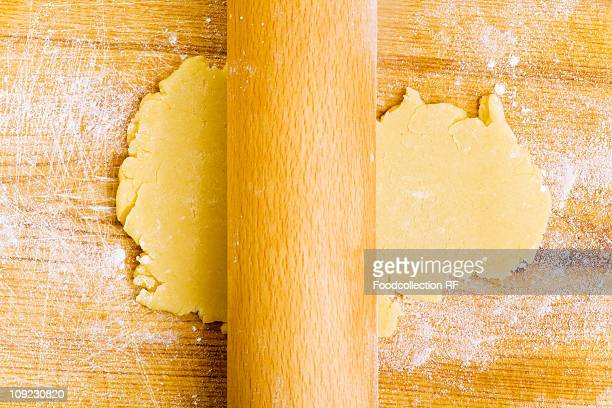 Rolling out biscuit dough with rolling pin, close-up