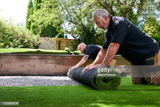 rolling out second roll - landscaped stock pictures, royalty-free photos & images