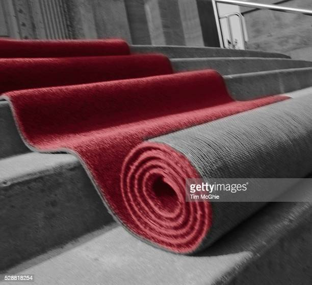 rolling out the red carpet - red carpet event stock pictures, royalty-free photos & images