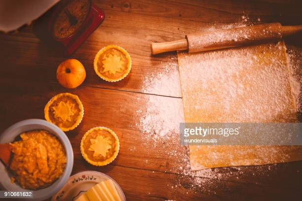 rolling pin, flour and dough preparation for small cakes - old fashioned thanksgiving stock photos and pictures