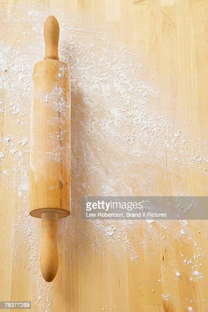Rolling pin on floured butcher block