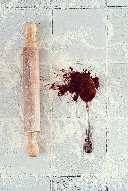 Rolling pin, teaspoon, flour and cocoa
