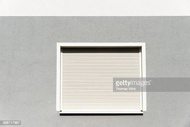 rolling shutters over a window - industrial door stock pictures, royalty-free photos & images