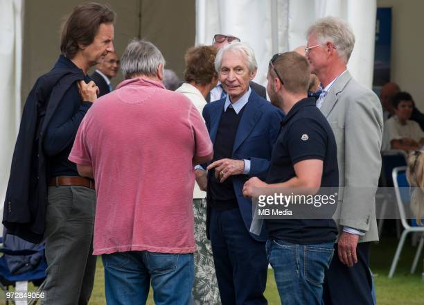 Rolling Stone drummer Charlie Watts chats to officials during the second innings of the oneoff ODI at the Grange Cricket Club on June 10 2018 in...