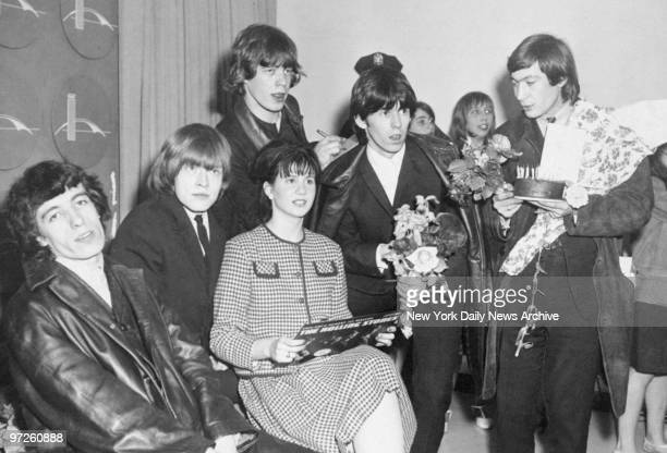 Rolling Stone fan Christine Berlin joins the Stones Bill Wyman Brian Wilson Mick Jagger Keith Richards and Charlie Watts on their arrival at Kennedy...