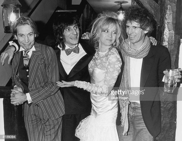 Rolling Stone guitarist Ronnie Wood celebrates with friends in Gerrards Cross Buckinghamshire after his wedding to girlfriend Jo Howard 2nd January...