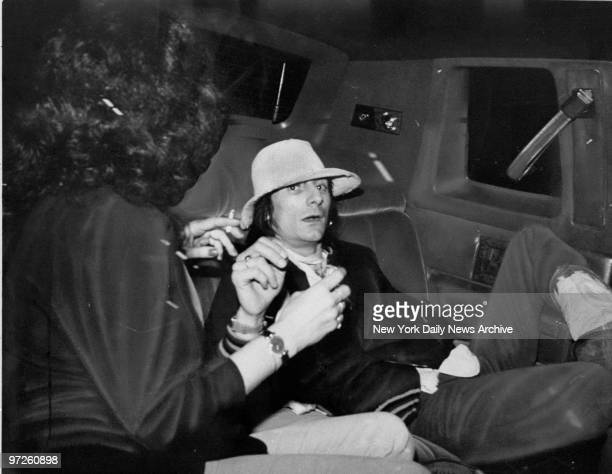 Rolling Stone member Ron Wood just released from prison in St Martin in back of limosine after James Brown concert at Studio 54