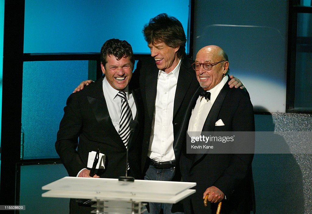 Rolling Stone Publisher Jann Wenner is inducted into the Rock and Roll Hall of Fame as Mick Jagger and Ahmet Ertegun congratulate him.