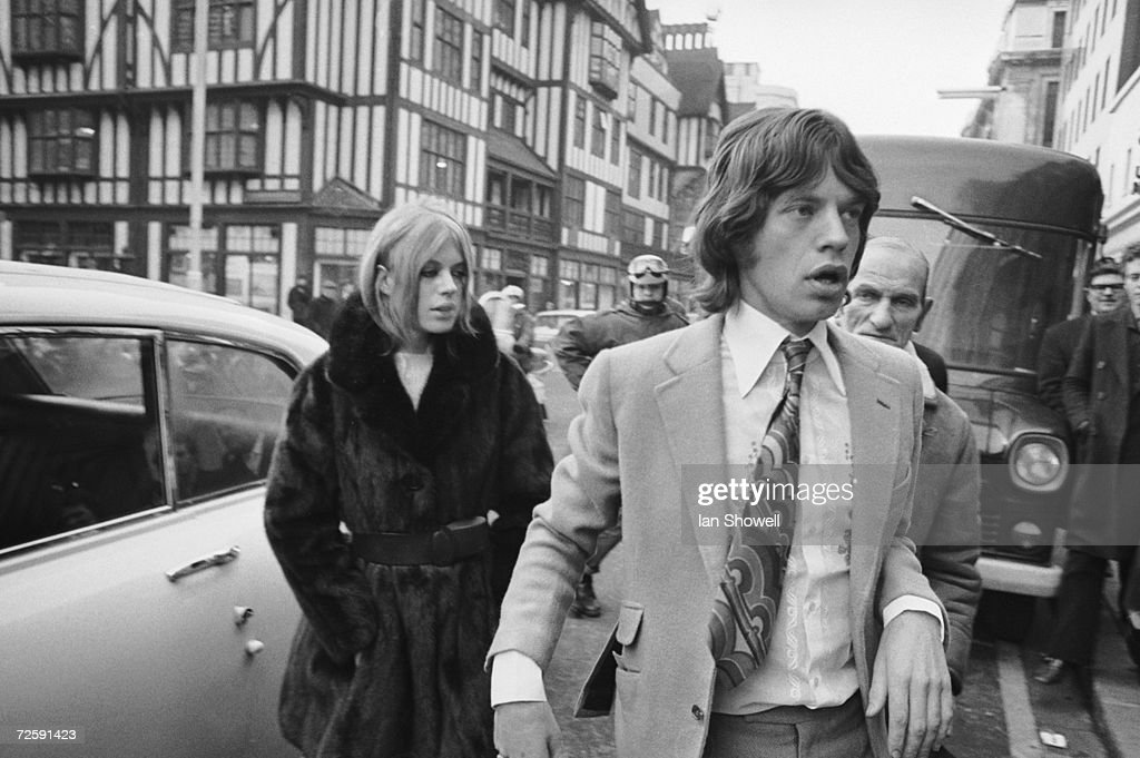 Rolling Stone singer Mick Jagger and his former girlfriend, singer and actress Marianne Faithfull, arriving at Marlborough Street court to answer charges of possessing cannabis, 18th December 1969.