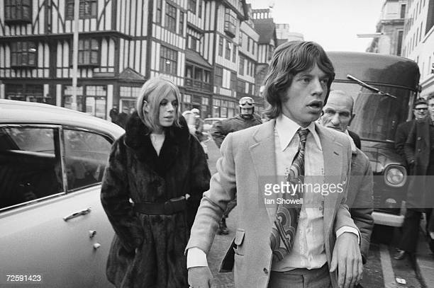 Rolling Stone singer Mick Jagger and his former girlfriend, singer and actress Marianne Faithfull, arriving at Marlborough Street court to answer...