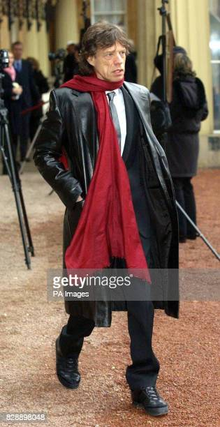 Rolling Stone Sir Mick Jagger after he received his Knighthood for services to popular music during a ceremony held at Buckingham Palace by the...