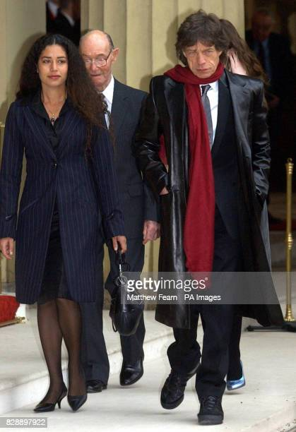 Rolling Stone Sir Mick Jagger father Joe and his daughter Karis after he received his Knighthood for services to popular music during a ceremony held...