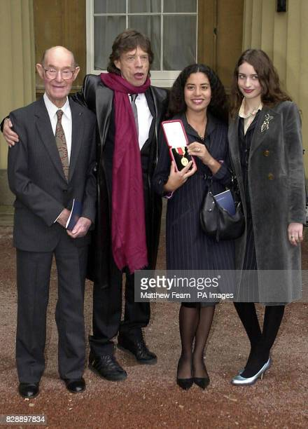 Rolling Stone Sir Mick Jagger with his proud 92yearold father Joe and daughters Elizabeth and Karis who holds aloft the knighthood he received for...