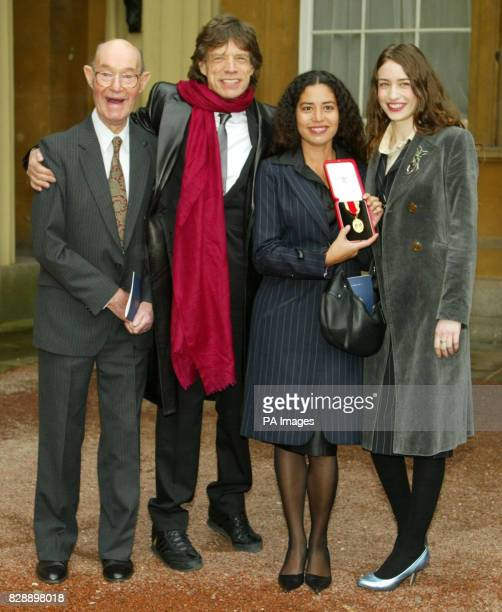 Rolling Stone Sir Mick Jagger with his proud 92yearold father Joe and daughters Elizabeth and Karis with the the knighthood he received for services...