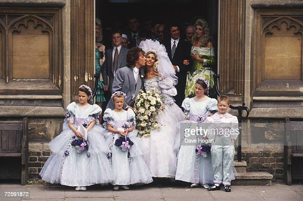Rolling Stones bassist Bill Wyman and Mandy Smith with pageboy and bridesmaids after the blessing of their marriage at St Johns Church London 5th...