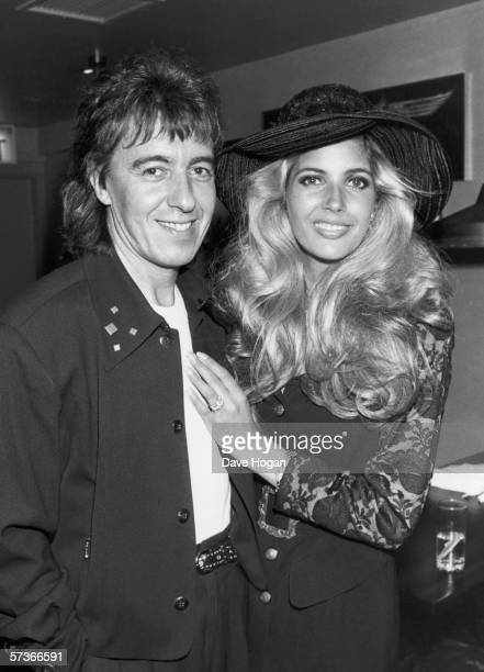 Rolling Stones bassist Bill Wyman with his bridetobe Mandy Smith at the opening of his new burger bar Sticky Fingers in London's Kensington May 1989