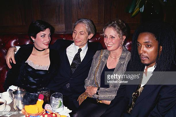 Rolling Stones drummer Charlie Watts sits with wife Shirley daughter Seraphina Bernard Fowler and a friend
