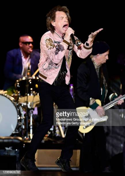 Rolling Stones drummer Steve Jordan , Mick Jagger , and guitarist Keith Richards perform during the first of two shows at SoFi Stadium as a part of...
