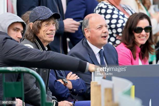 Rolling Stones front man British singer Mick Jagger watches play on day three of Ireland's inaugural test match against Pakistan at Malahide cricket...