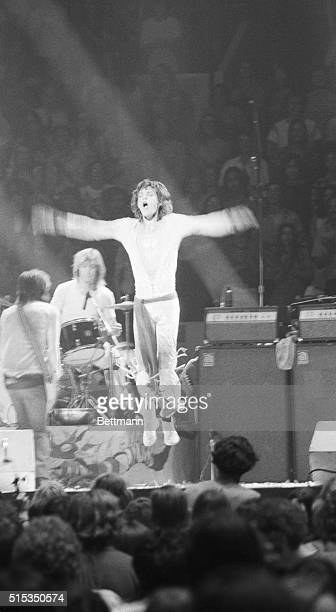 Rolling Stones' frontman Mick Jagger jumps with arms outstretched during a Stones' concert at Madison Square Garden