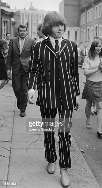 Rolling Stones guitarist Brian Jones leaving West London Magistrates Court looking natty in a boldly striped suit