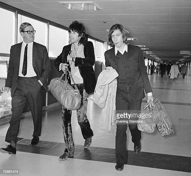 Rolling Stones guitarist Keith Richards and drummer Charlie Watts at London Airport 8th December 1969