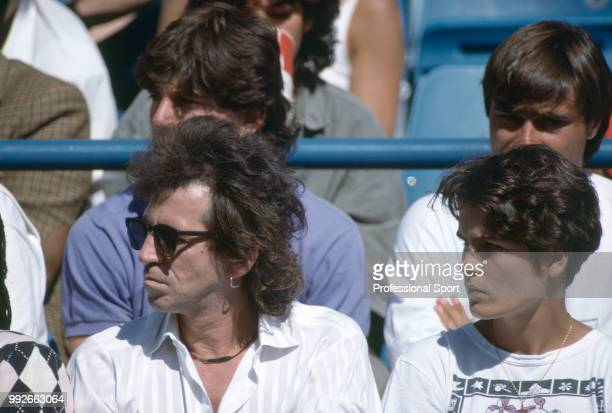 Rolling Stones guitarist Keith Richards and Sonya Mulholland wife of Mats Wilander watch Wilander playing a match during the US Open at the USTA...