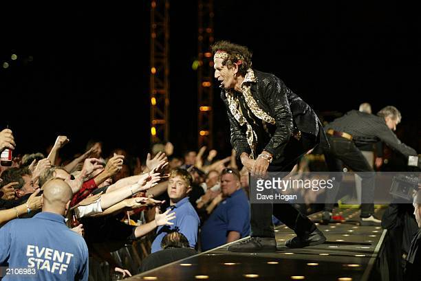 Rolling Stones guitarist Keith Richards on stage during the band's 'Licks' tour at the Gillette Stadium on September 5 2002 in Boston Massachusetts...