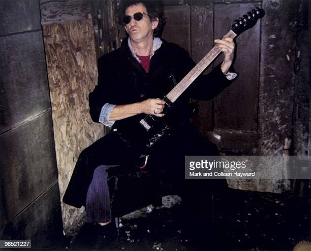 Rolling Stones guitarist Keith Richards playing backstage circa 1990