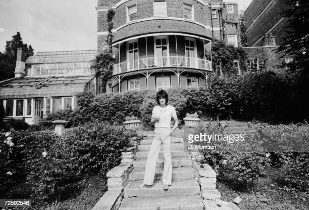 Rolling Stones guitarist Ron Wood at 'The Wick', his home in Richmond, Middlesex, 25th July 1974.