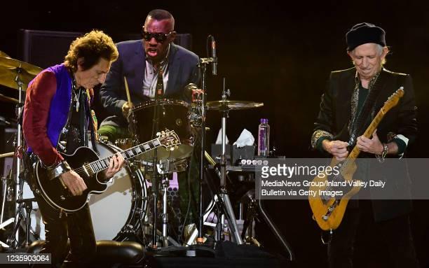 Rolling Stones guitarist Ron Wood , drummer Steve Jordan and guitarist Keith Richards perform during the first of two shows at SoFi Stadium as a part...
