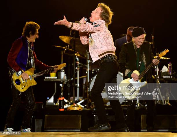 Rolling Stones guitarist Ron Wood , Mick Jagger , and guitarist Keith Richards perform during the first of two shows at SoFi Stadium as a part of the...