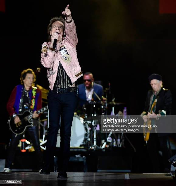 Rolling Stones guitarist Ron Wood , Mick Jagger , drummer Steve Jordan and guitarist Keith Richards perform during the first of two shows at SoFi...