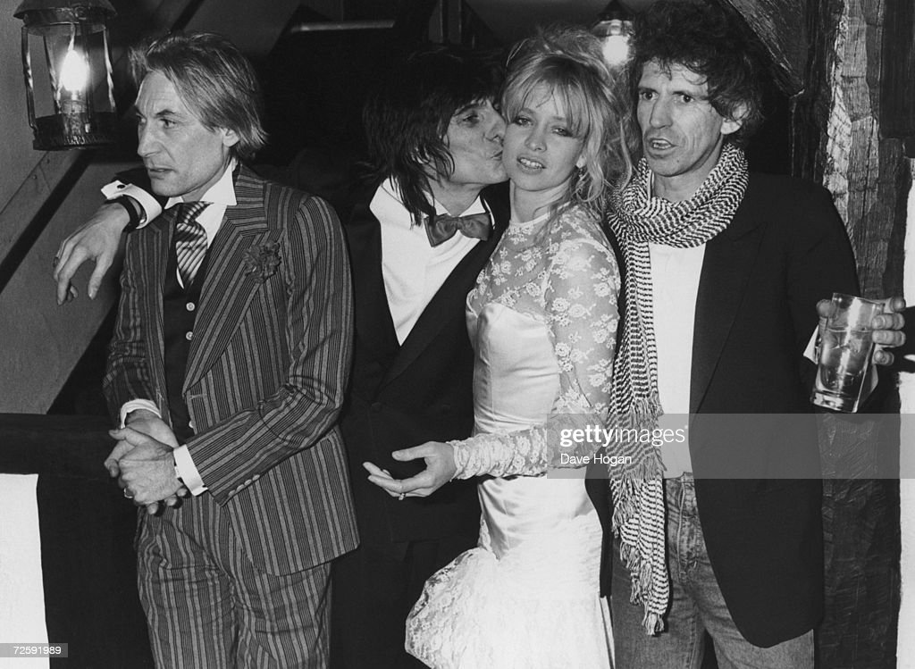 Rolling Stones guitarist Ronnie Wood celebrates with friends in Gerrards Cross, Buckinghamshire, after his wedding to girlfriend Jo Howard, 3rd January 1985. Accompanying the happy couple are best men and fellow Stones Charlie Watts, left, and Keith Richards.