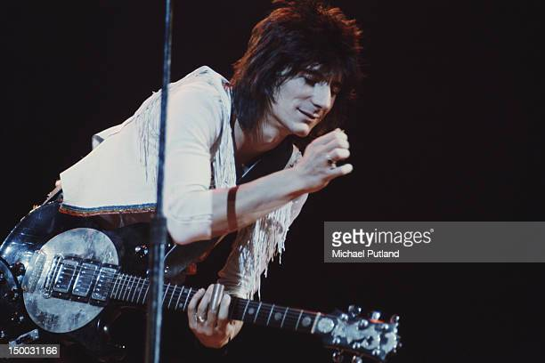 Rolling Stones guitarist Ronnie Wood performing on stage circa 1975